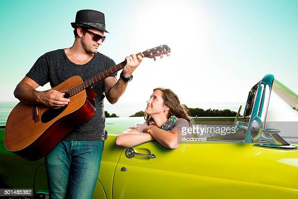 Couple by a Blue Convertible