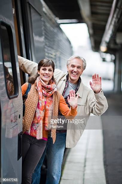 A couple by a train at a railway station Sweden.
