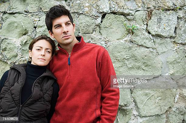 Couple by a wall