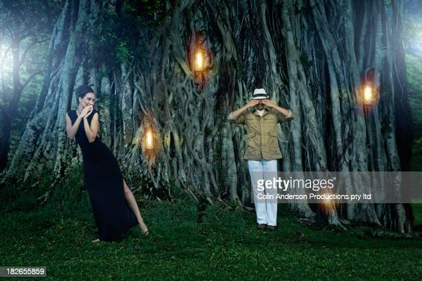 couple by illuminated banyan tree - banyan tree stock pictures, royalty-free photos & images