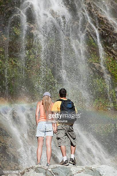 couple by scenic waterfall - bariloche stock pictures, royalty-free photos & images