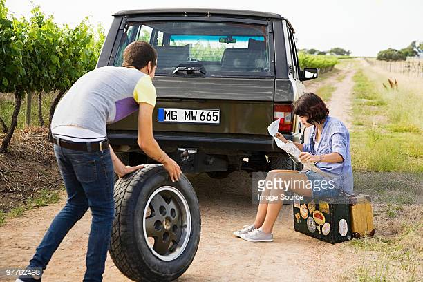 couple by suv with tyre and map - partire bildbanksfoton och bilder