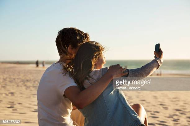 Couple by the beach at sun set