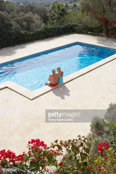 couple by the pool - next to stock pictures, royalty-free photos & images