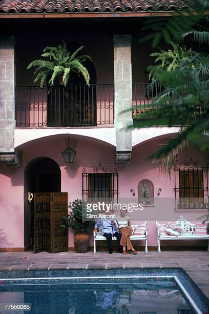 A couple by the swimming pool at their villa in Cuernavaca Mexico 1980