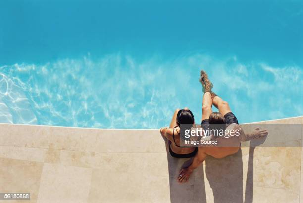 couple by the swimming pool - poolside stock pictures, royalty-free photos & images