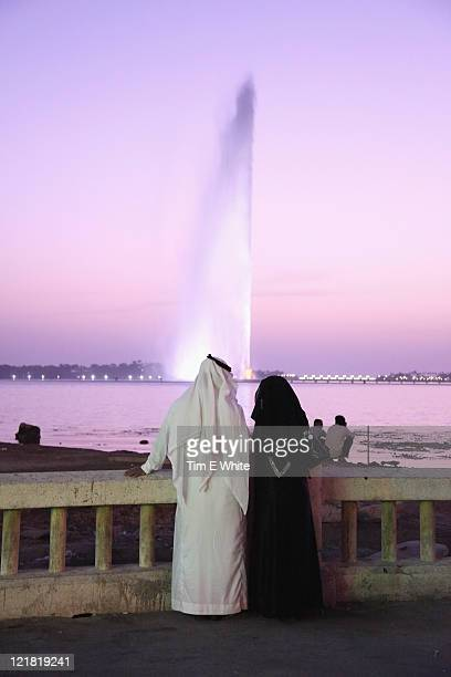 Couple by the worlds tallest fountain in Jeddah, Saudi Arabia