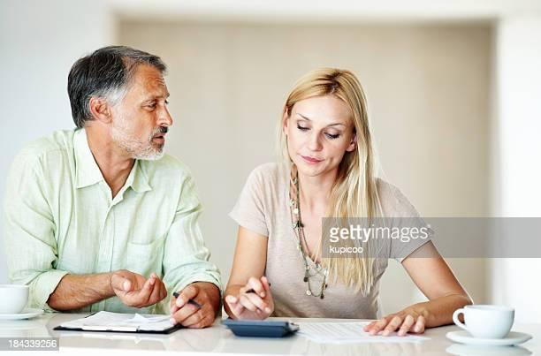 Couple calculating domestic bills
