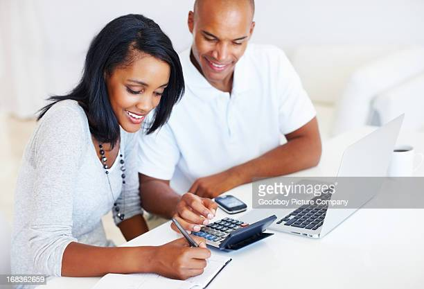 Couple calculating monthly expenses