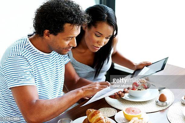 Couple calculating their home expenses