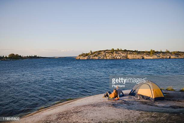Couple camping by sea