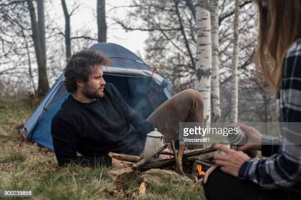 Couple camping in forest