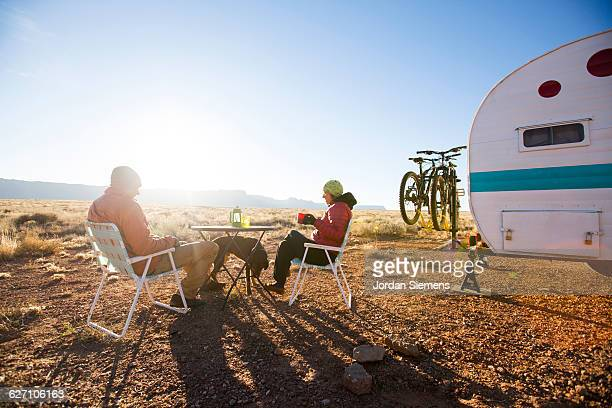 A couple camping in the desert.