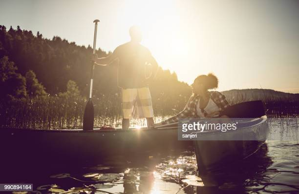 couple canoeing on the lake - adults only stock pictures, royalty-free photos & images