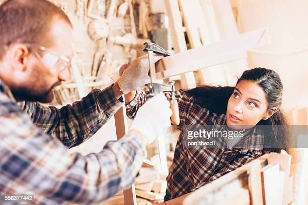 Couple carpenter workers at workshop