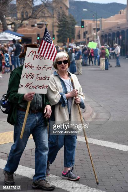 Couple carries an anti-NRA sign at a 'March For Our Lives' rally in Santa Fe, New Mexico. The rally and march, part of a nationwide series of similar...