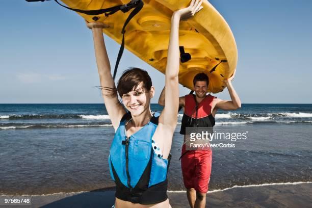 Couple Carrying a Sea Kayak