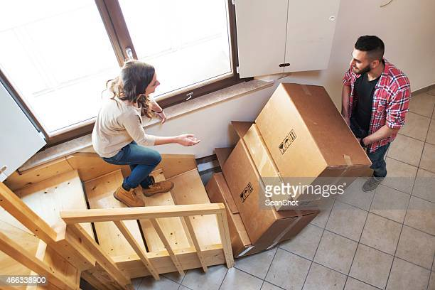 Couple Carrying Boxes During a Moving