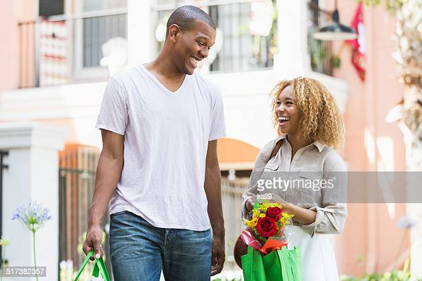 Couple carrying grocery bags
