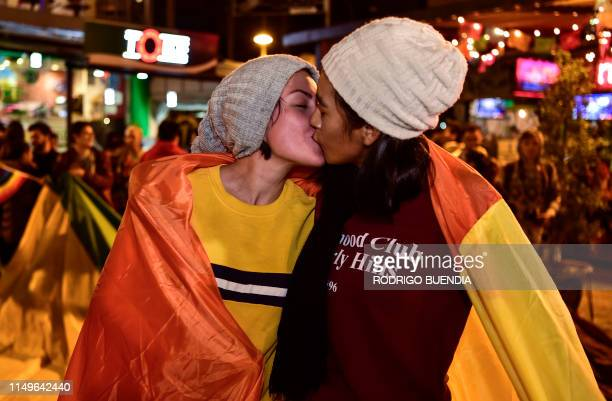 A couple celebrate with a kiss after the Ecuador's Constitutional Court approved equal civil marriage in Guayaquil Ecuador on June 12 2019 Ecuador's...