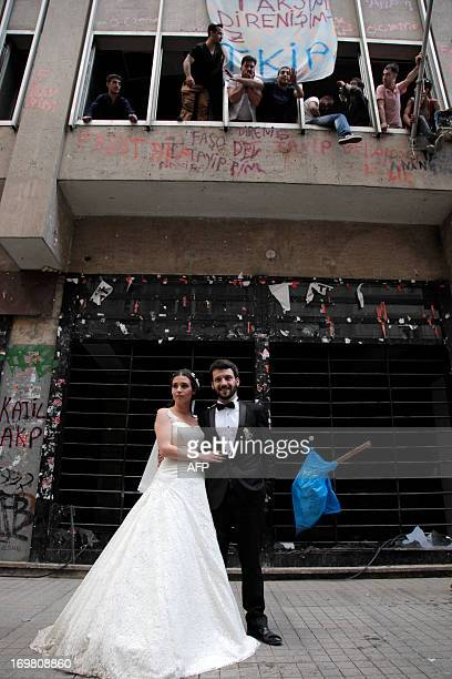 A couple celebrates their wedding as people demonstrate on Taksim square on June 2 a day after Turkish police pulled out of Istanbul's iconic square...