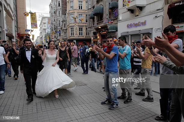 A couple celebrates their wedding with demonstrators near Taksim square on June 2 a day after Turkish police pulled out of Istanbul's iconic square...