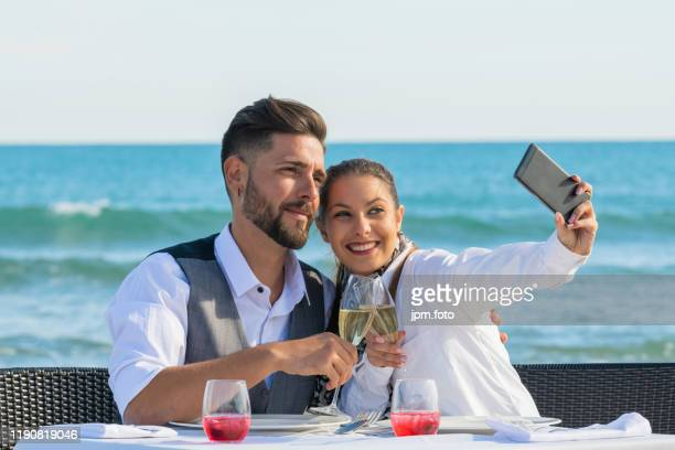 couple celebrating valentines day beach make