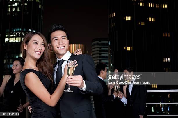 Couple Celebrating at an Outdoor Bar