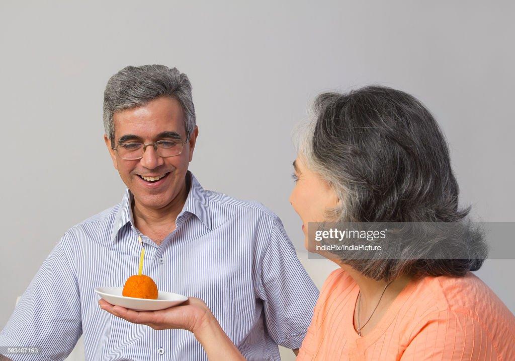 Couple celebrating birthday : Stock Photo