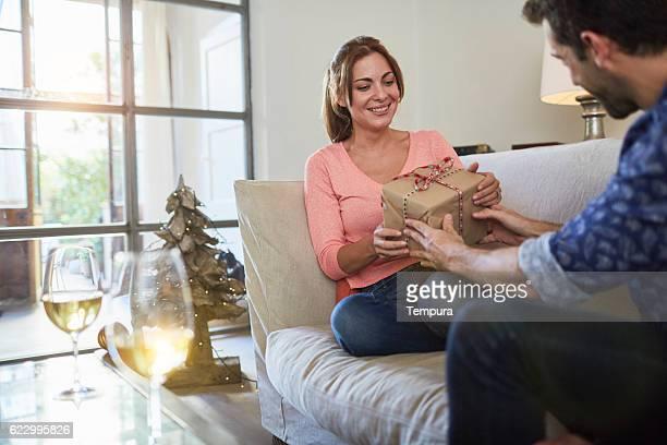 Couple celebrating christmas at home.