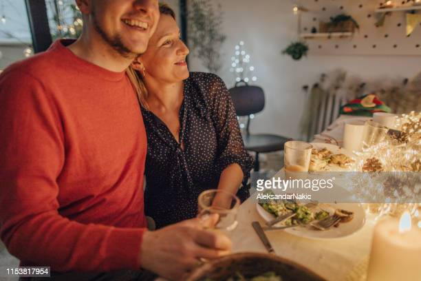 couple celebrating christmas - thanksgiving decoration stock pictures, royalty-free photos & images