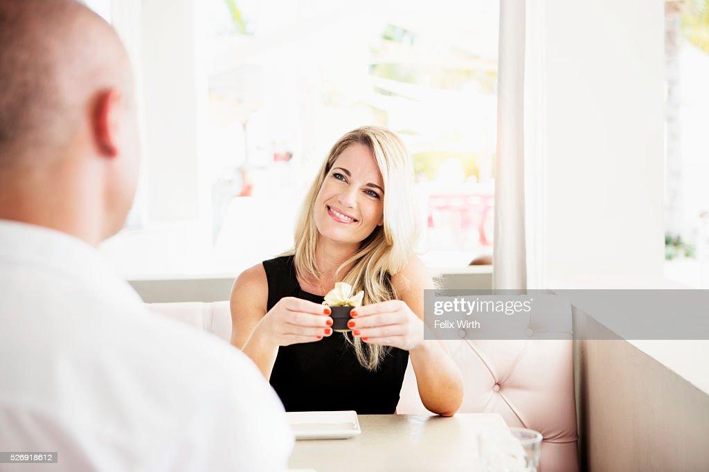 Couple celebrating engagement in restaurant : Stock Photo