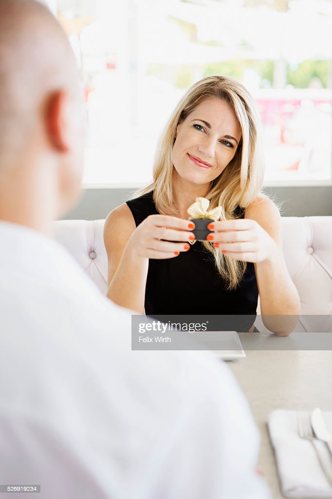 Couple celebrating engagement in restaurant : Stock Photo