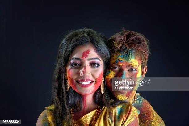 Couple celebrating Holi with colors.