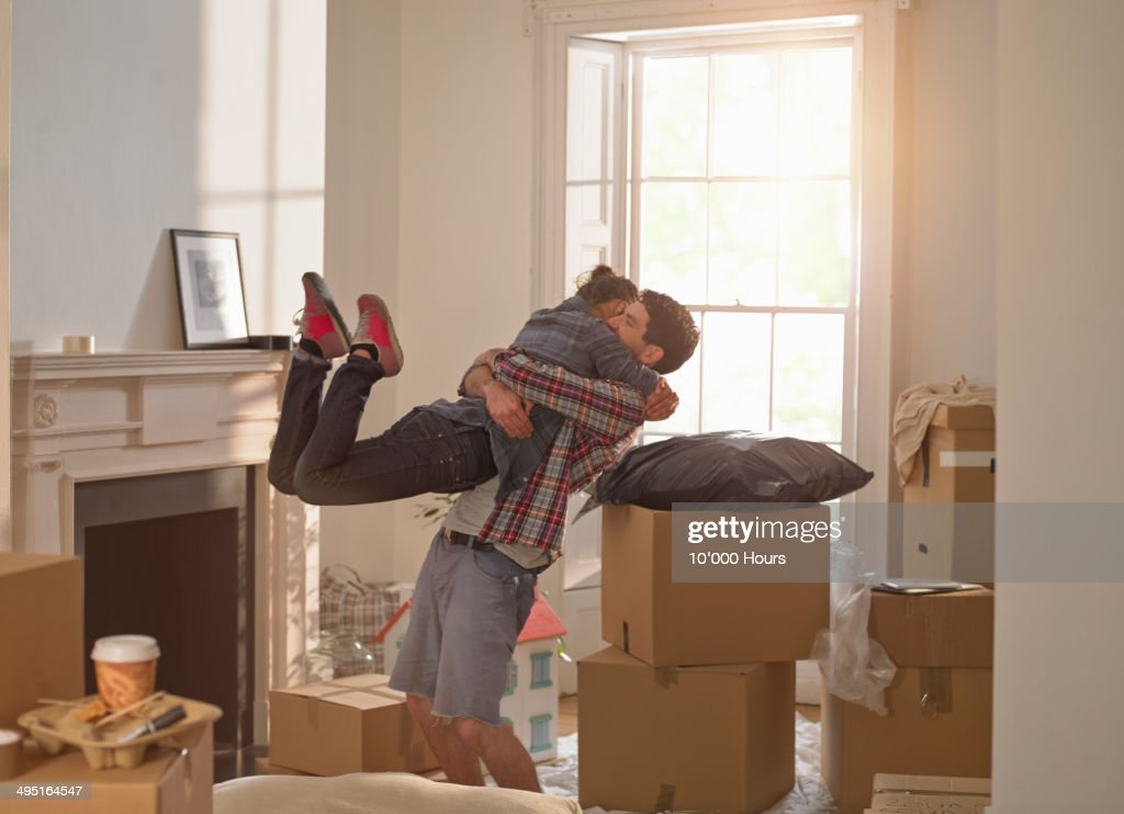 A couple celebrating moving in to a new home : Stock Photo