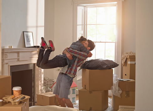 A couple celebrating moving in to a new home - gettyimageskorea