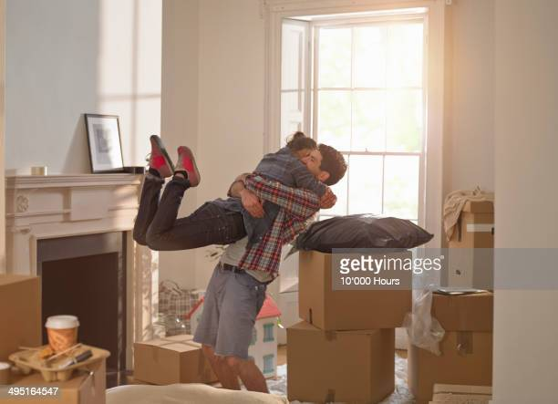 a couple celebrating moving in to a new home - home ownership stock pictures, royalty-free photos & images