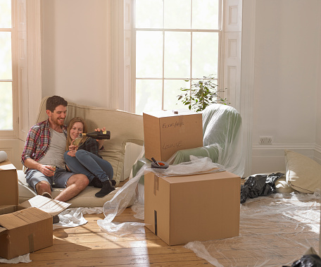 A couple celebrating moving into their new home - gettyimageskorea