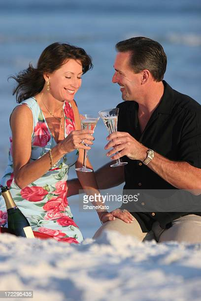 couple celebrating on beach - destin beach stock pictures, royalty-free photos & images