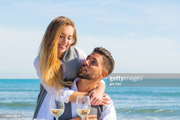 couple celebrating valentines day beach celebration