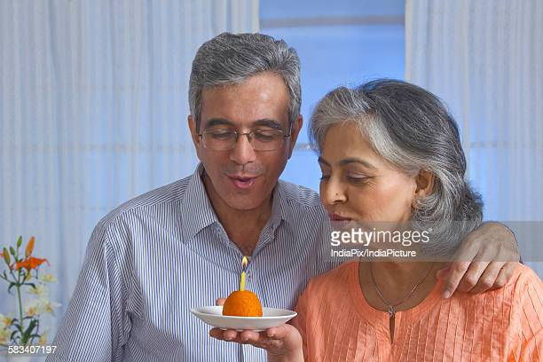 couple celebrating their wedding anniversary - mithai stock pictures, royalty-free photos & images