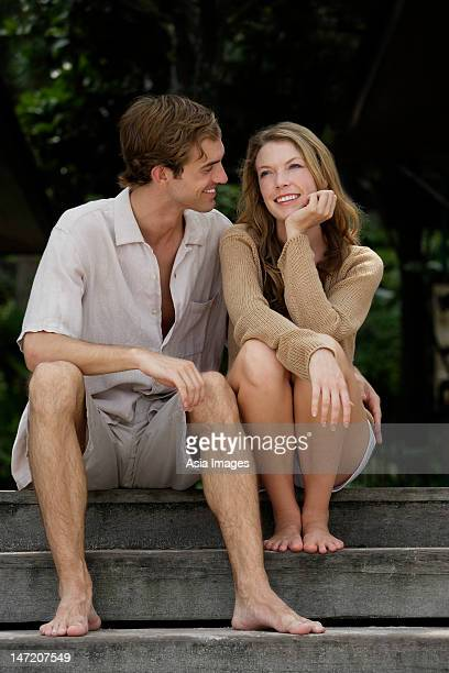 couple chatting on steps