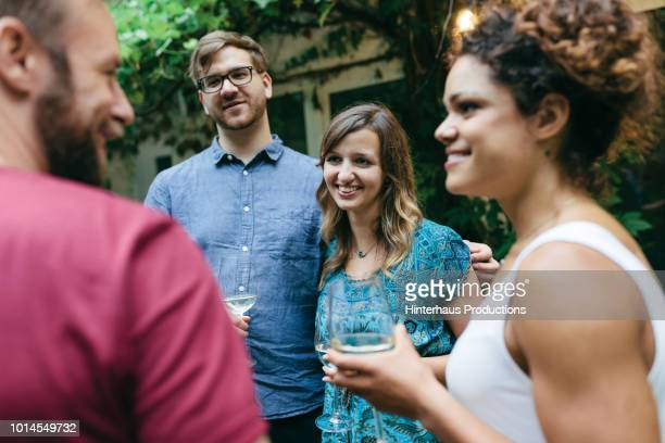 couple chatting with friends after outdoor meal - sleeveless top stock photos and pictures