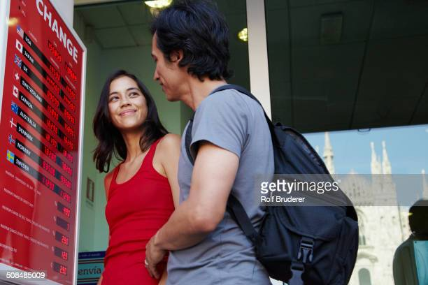 Couple checking currency exchange rates