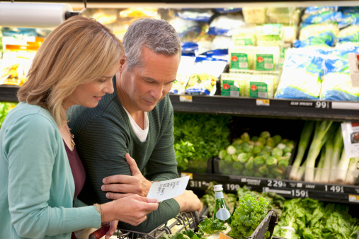 Couple checking grocery list in supermarket - gettyimageskorea