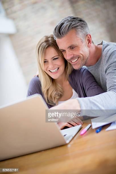 Couple checking home finances