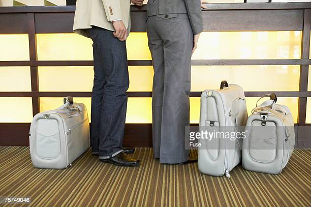 Couple Checking Into a Hotel
