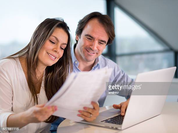 Couple checking their home finances