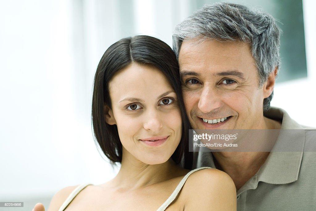 Couple cheek to cheek, smiling at camera, portrait : Stock Photo