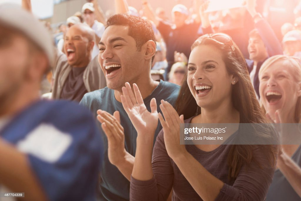 Couple cheering at sporting event : Stock Photo